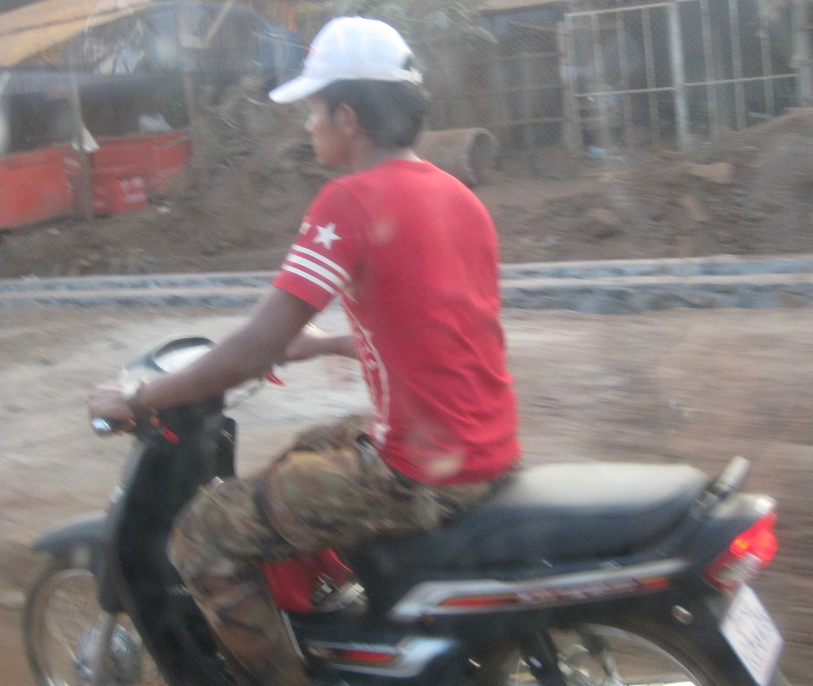 Cambodian Guy on a Moto